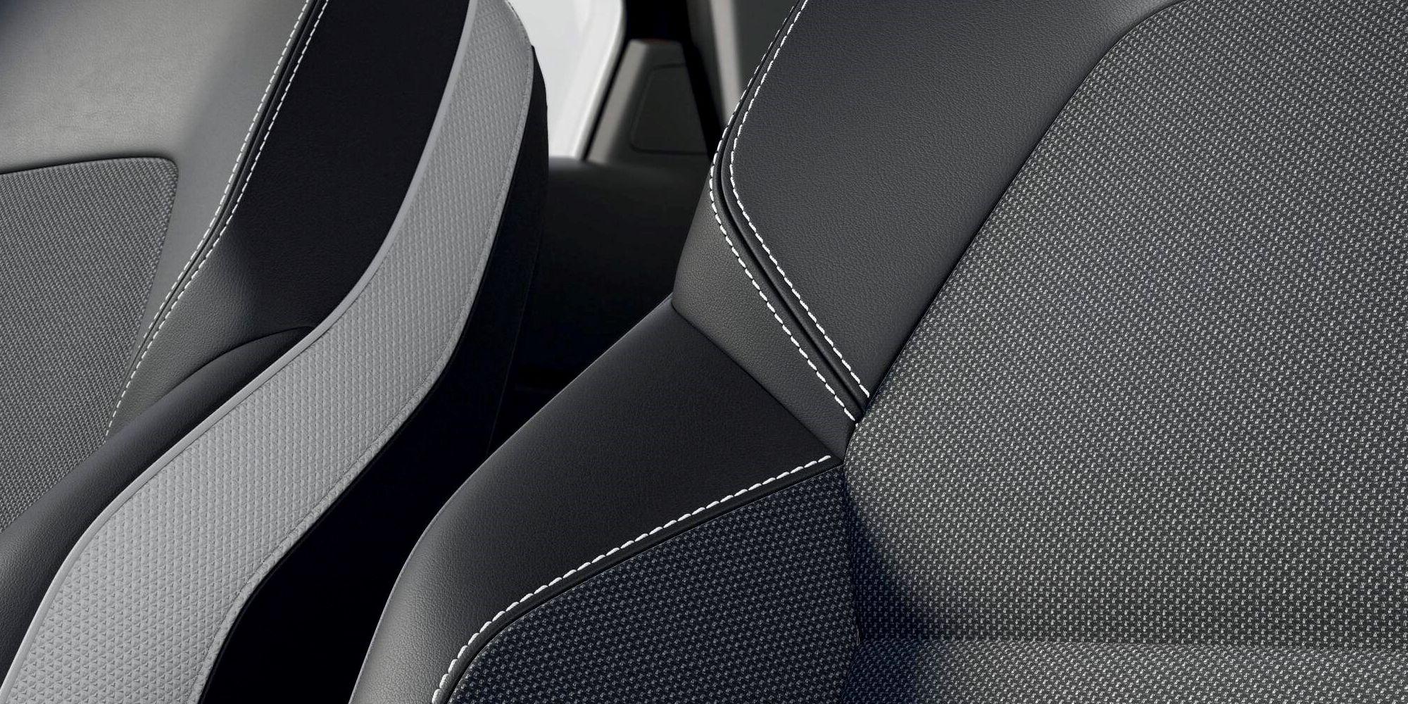 Musta ja halli värvi tekstiilist istmekatted
